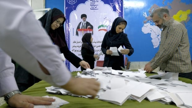 Election officials count ballot papers in Tehran on Friday during elections for the parliament and a leadership body called the Assembly of Experts. Moderates won majorities in both bodies.