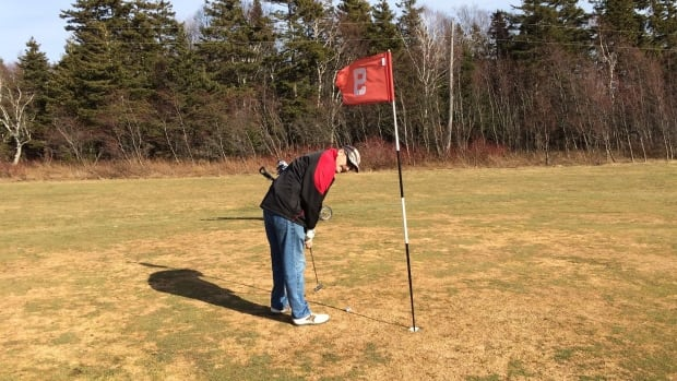 About to sink a putt on the French River Golf Course Feb. 29, 2016.