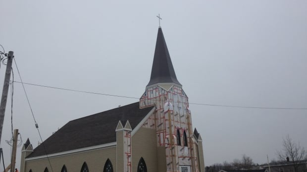 A steel cross was added to St. Mary's Polish Church in Whitney Pier, Cape Breton, bringing the rebuild one step closer to completion after it burned down in 2014.