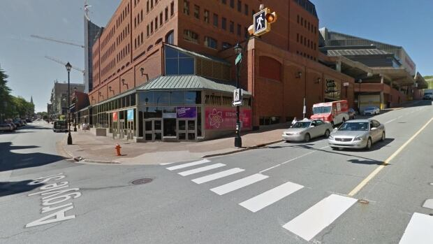 The 51-year-old pedestrian was crossing the street in the marked crosswalk by the World Trade and Convention Centre when she got hit by the car late Monday afternoon.