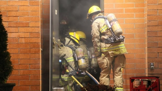 Burnaby firefighters were alerted by the fire alarms and arrived to find smoke coming from the church. They soon learned the priest was inside and moved in to rescue the man.