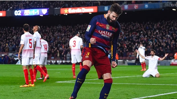 Gerard Pique celebrates after scoring Barcelona's second goal versus Sevilla FC, helping the Catalans tie the Spanish record of 34 straight unbeaten games.