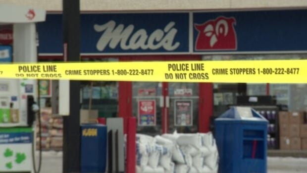 Police tape surrounded one of the Edmonton Mac's stores where an employee was killed on the job in December.