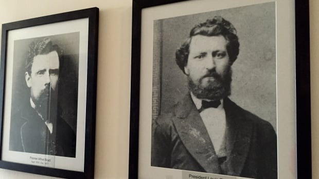 A photo of Louis Riel (right) was unveiled at the Manitoba Legislature Tuesday. The province has formally recognized the Metis figure as the first leader of Manitoba.