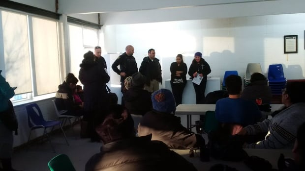 Police and volunteers gather at the Kenora Fellowship Centre as they continue to comb through the area for Delaine Copenace, who has been missing since Feb 27