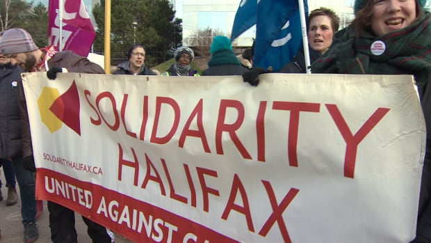 Members of the Halifax Typographical Union were joined by other labour union members in Nova Scotia during a rally in front of the Chronicle Herald office in Halifax on Wednesday.