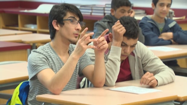 Refugee high school students get extra help learning English in an after school program.