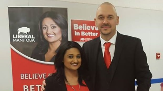 "Jamie Hall, right, stands with Liberal Leader Rana Bokhari in a photo posted on her Facebook page on Tuesday evening.  Today she said missing his social media posts was ""massive mistake"" on the part of her party."
