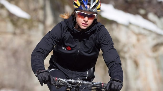 Canadian triathlete Kirsten Sweetland rides a bicycle while training in Whistler, B.C. She usually spends the winter in warm climates preparing for the gruelling season ahead, but the Victoria native believed she would be happier on home soil as she gears up for a third and final crack at the Olympics after a career marred by injuries, illness and heartbreak.