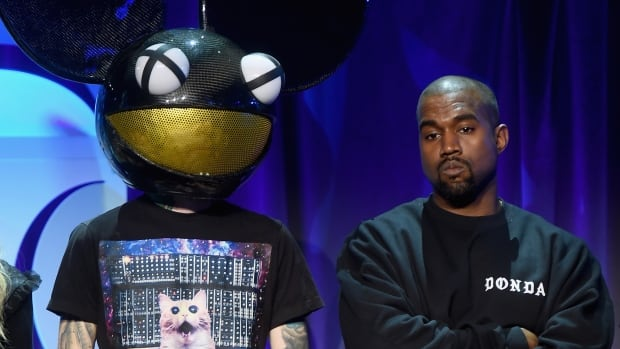 Deadmau5, left, and Kanye West, pictured here at the launch of the streaming music service Tidal, sparred on Twitter on Wednesday.