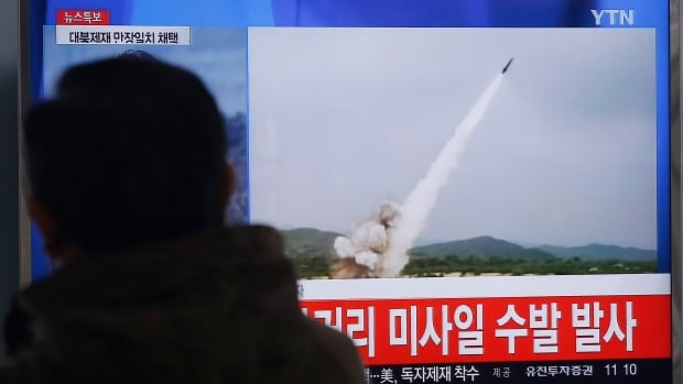 A man watches a TV news program showing a file footage of the missile launch conducted by North Korea, at Seoul Railway Station in Seoul on Thursday. North Korea fired several short-range projectiles into the sea off its east coast, Seoul officials said.