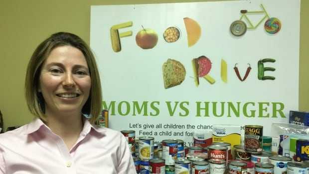 Angela Lawlor is a member of the Moms vs Hunger group collecting food and money to help combat childhood poverty.