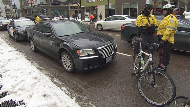Police allege a man stole this taxi in Cobourg before leading police on a lengthy chase that ended near Ryerson University in downtown Toronto.