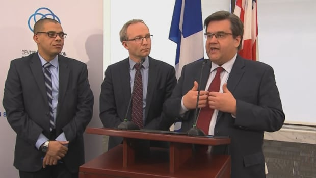 Montreal Mayor Denis Coderre (right), accompanied by Public Security Minister Martin Coiteux (centre) and director of Montreal's anti-radicalization centre Herman Deparice Okomba, said the centre's approach will have global reach.
