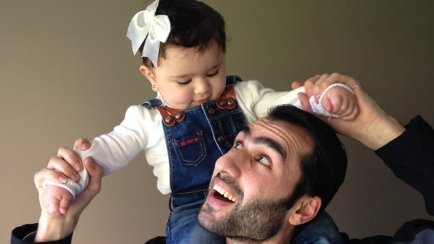 Syrian refugee Mohammad Almostafa, pictured here with his daughter Jana.