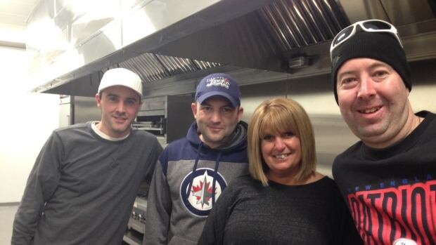 """Managing partner Leena Lem  (second from right) says she's looking forward to """"letting Tony Roma's be Thunder Bay's new home."""" She is surrounded by chef Cory Thompson (left), Daniel Edwards, and Paul Palmer (right), all of whom relocated from Alberta."""