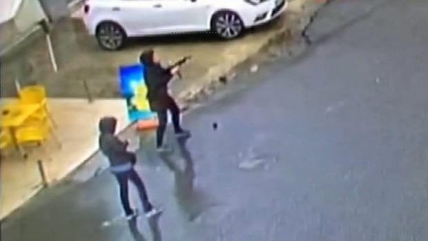 Security camera footage shows two women as they attack police in Istanbul, Turkey, on Thursday.  The pair hid in a nearby building but were found and killed by police.