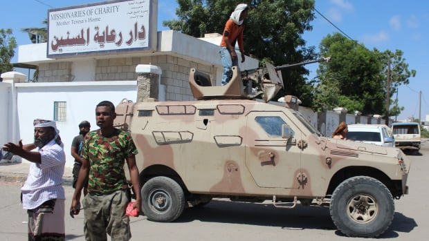 Yemeni security forces gather outside an elderly care home in Yemen's main southern city of Aden after it was attacked by gunmen on Friday. Sixteen people, including four nurses, were killed when the gunmen opened fire, security officials said.