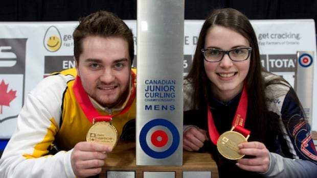 Manitoba skip Matt Dunstone, right, and Nova Scotia skip Mary Fay show off their medals from the World Junior Curling Championship in Denmark .