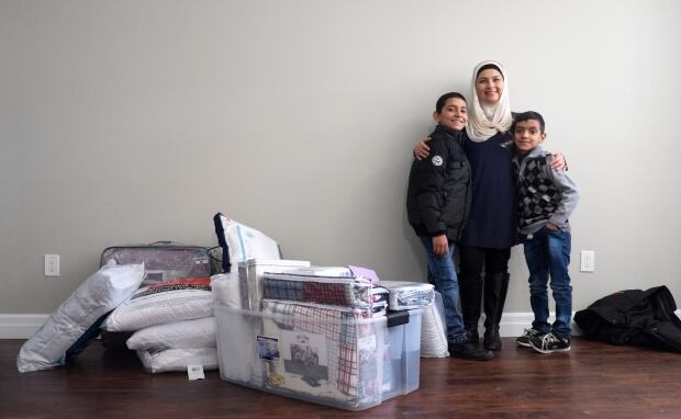 Mariela Barazi with family and donations