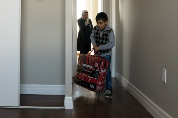 Mohammed Matar moves into his new apartment
