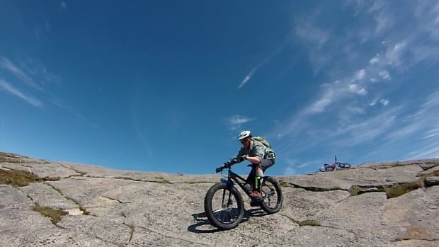 Fat bike on Newfoundland rocks