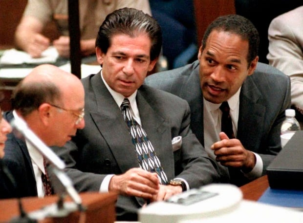 O.J. Simpson consulting with friend Robert Kardashian