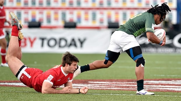 Pat Kay of Canada, left, misses a tackle against Rosko Specman of South Africa during the USA Sevens Rugby tournament at Sam Boyd Stadium on Friday in Las Vegas, Nevada.