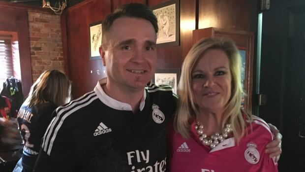 Kirk and Robin White say their soccer themed wedding in a pub was perfect way to say I do.