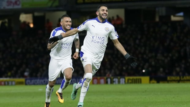 Leicester's Riyad Mahrez celebrates after scoring a goal during the English Premier League soccer match between Watford and Leicester City.
