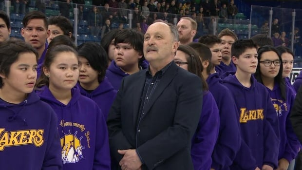 NHL great Bryan Trotter was at centre ice with youngsters from La Loche, Sask., at a Saskatoon Blades hockey game Saturday.