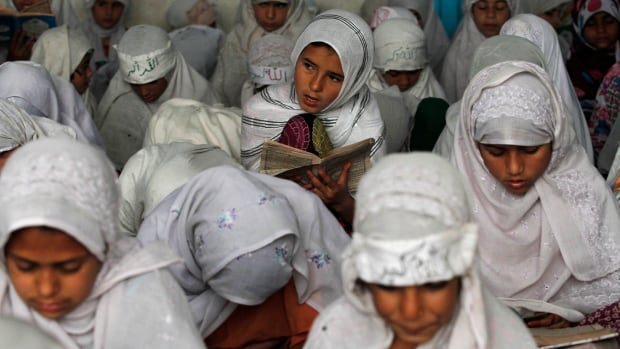 Afghan girls read the Qur'an at a mosque in Kandahar, Afghanistan on March 2, 2016.