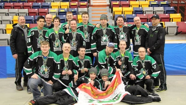 Special Olympics P.E.I. floor hockey team celebrates their gold medal win in the C division with a 7-2 win over Team Newfoundland.