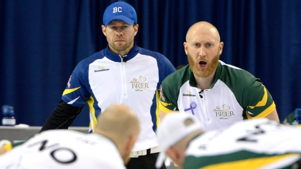 Northern Ontario skip Brad Jacobs, right, calls out while B.C. Jim Cotter looks on in the fifth draw at the Brier.