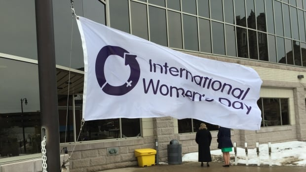 The International Women's Day flag at the base of the flag pole at Thunder Bay City Hall.  Coun. Paul Pugh and Gwen O'Reilly of the Northwestern Ontario Women's Centre raised it to mark International Women's Day March 8.
