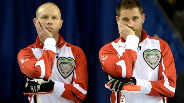 Team Canada skip Pat Simmons, left, and third John Morris, shown while they had a perfect record at the Brier, lost their second game Monday, 10-6 to Brad Jacobs and Northern Ontario, after opening with three points in the first end.
