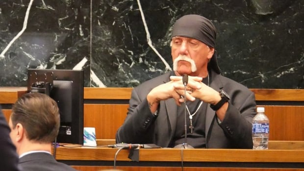 Terry Bollea, known as professional wrestler Hulk Hogan, listens while testifying in his case against the news website Gawker at the Pinellas County Courthouse, in St. Petersburg, Fla., on Monday.