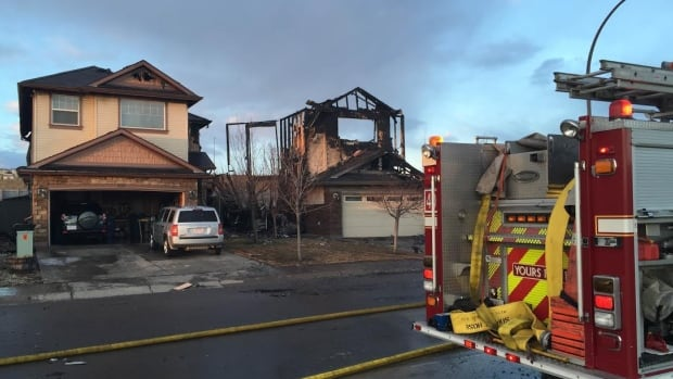 An early morning fire in Kincora in northwest Calgary destroyed three homes and badly damaged a fourth.