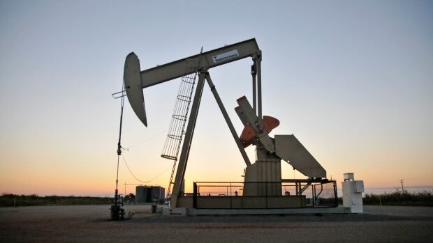 A pump jack operates at a well site leased by Devon Energy Production Company near Guthrie, Oklahoma September 15, 2015. State regulators asked oil and natural gas producers in central Oklahoma to decrease their wastewater disposal operations to try to temper the sharp increase in the number and severity of earthquakes in the energy-rich state.