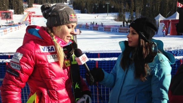 Andi Petrillo, right, interviews American skier Lindsay Vonn in Lake Louise, Alta., in December 2013.