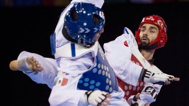 Canada's Maxime Potvin, right, competes against Mexico's Saul Gutierrez during his silver-medal performance in the men's under-68kg final taekwondo match at the Pan Am Games.