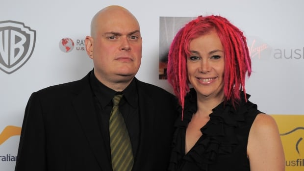 Lana Wachowski, right, is shown at a 2013 event in Beverly Hills, Calif., with brother Andy, who on Tuesday revealed she was transgender.