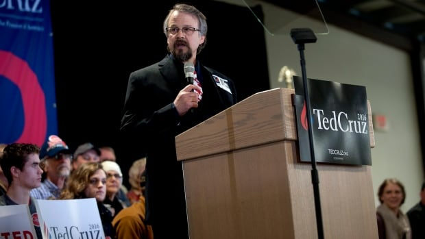 Pastor Tim Remington leads the prayer on Sunday during the rally for Republican presidential hopeful Ted Cruz at the Kootenai County Fairgrounds in Coeur d'Alene, Idaho. He was shot six times March 6 as he was leaving the Altar Church after Sunday services.