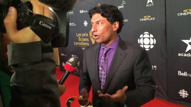 CBC host Ian Hanomansing speaks to reporters Tuesday night after winning the Canadian Screen Award for best national news anchor. The televised awards show, hosted by Norm Macdonald, will be broadcast on CBC Sunday night, when prizes in the acting categories, and for best movie and TV shows, will be handed out.