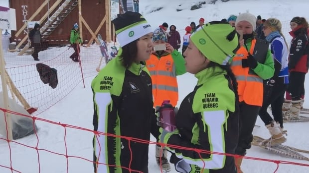 A pair of snowshoers from Nunavik caught the eye of a small crowd in Nuuk with a traditional warm up: Inuit throat singing.
