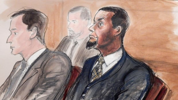 In this Feb. 24 courtroom file sketch, Tairod Pugh, right, sits at the defence table with his lawyer Zachary S. Taylor during jury selection in a federal court in the Brooklyn borough of New York.