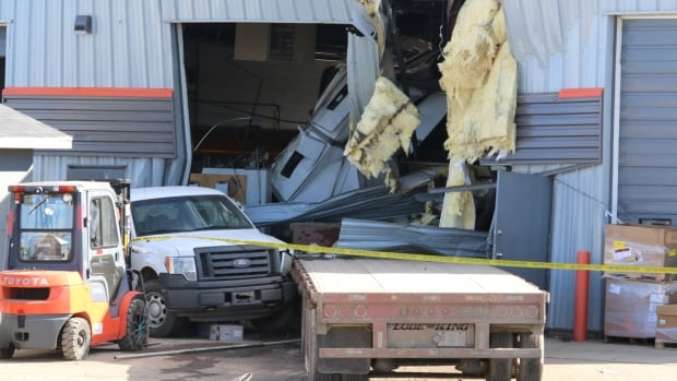 A truck slammed into a commercial building in Airdrie Wednesday afternoon.