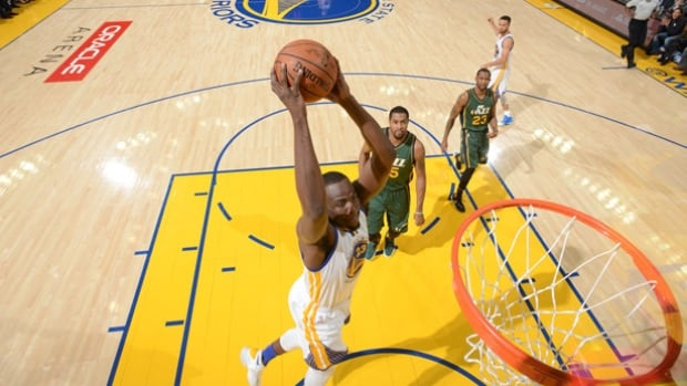 Golden State's Draymond Green slams home a two-hand dunk, part of his 17-point night as the Warriors cruised to a 115-94 win over the Utah Jazz, the Warriors' 46th consecutive victory at home.