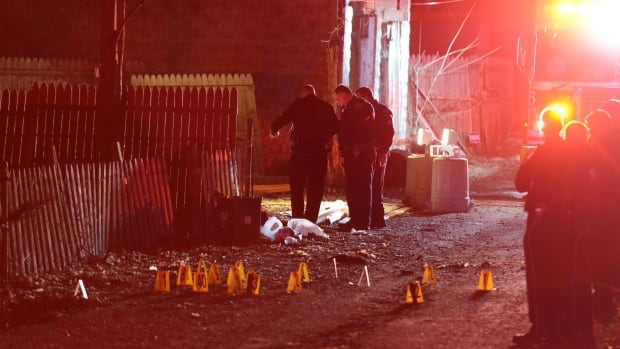 Police investigate the scene after a deadly shooting Wednesday night in Wilkinsburg, Pa. Police say multiple people were killed in the shooting and several were injured in suburban Pittsburgh.