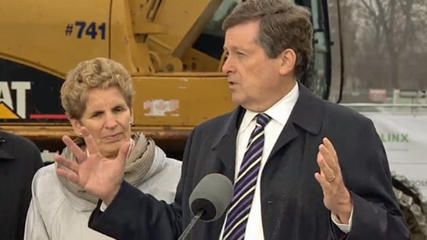 Premier Kathleen Wynne stands with Mayor John Tory near Eglinton Avenue in Toronto. She says the new LRT line will make a 'huge difference' for Torontonians.